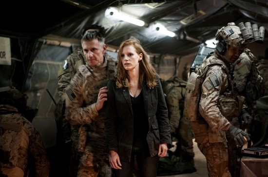 Stationed in a covert base overseas, Jessica Chastain (center) plays a member of the elite team of spies and military operatives who secretly devoted themselves to finding Osama Bin Laden in Columbia Pictures' electrifying new thriller directed by Kathryn Bigelow, ZERO DARK THIRTY.